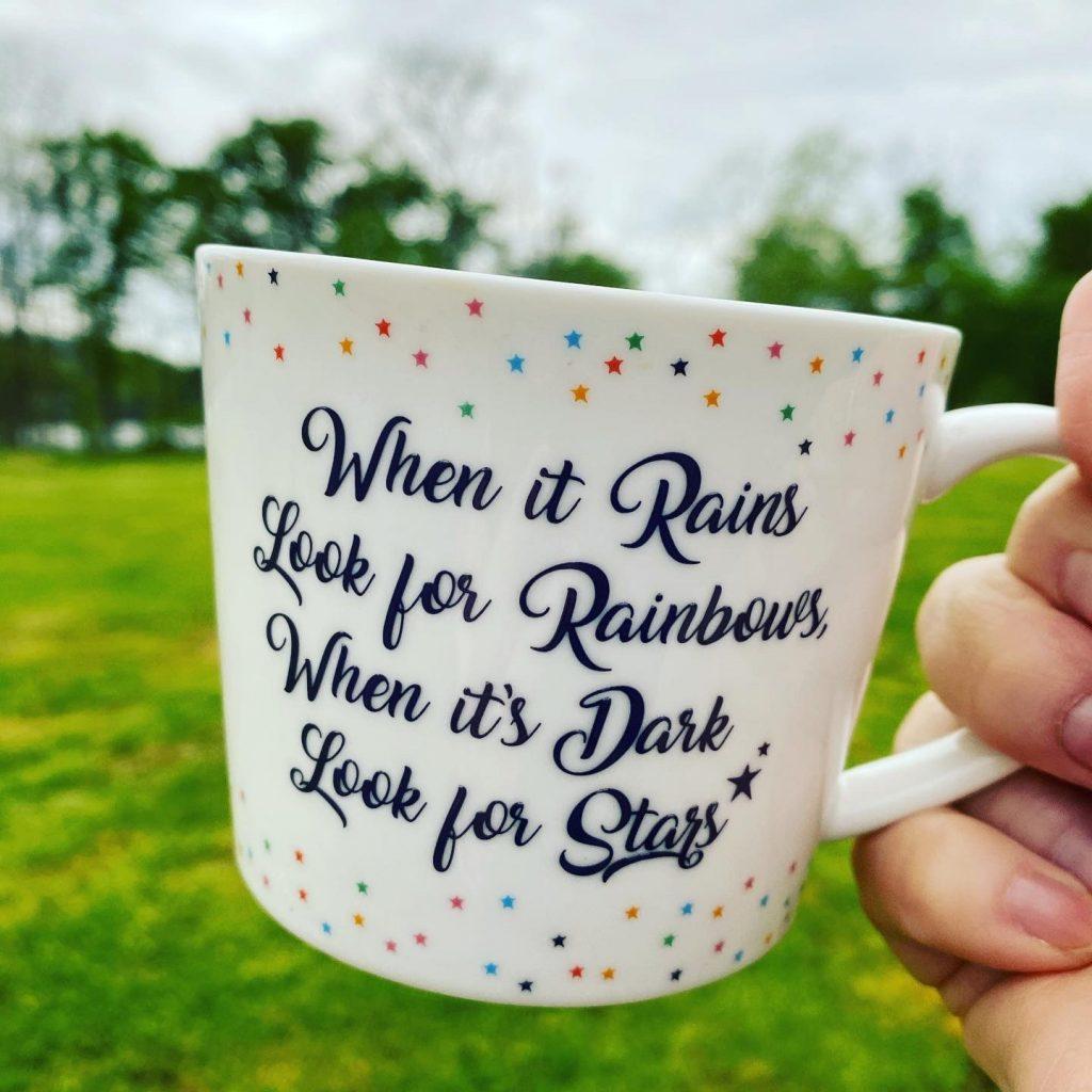Rainbows and stars coffee mug