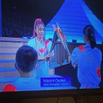 Naomi Osaka receives the torch