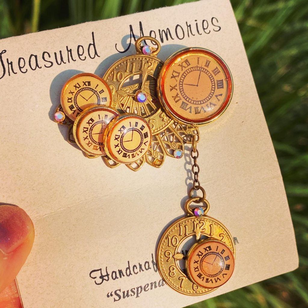 Suspended in time brooch