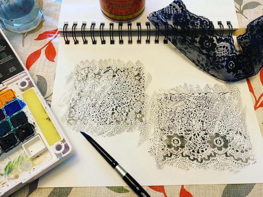 Watercolor over adhesive lace pattern